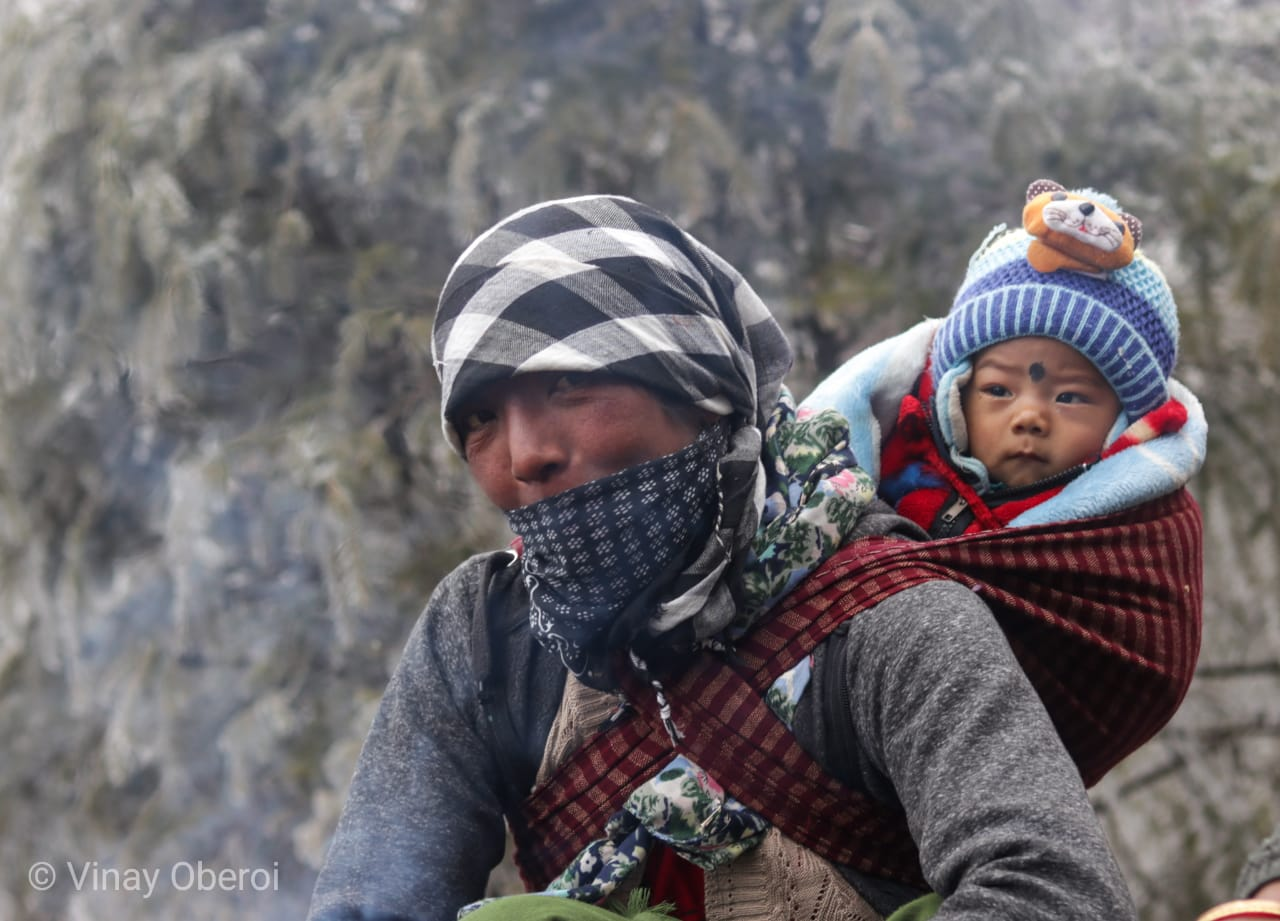 A road maintenance worker keeps the Sela pass open and the baby warm   Vinay Sheel Oberoi