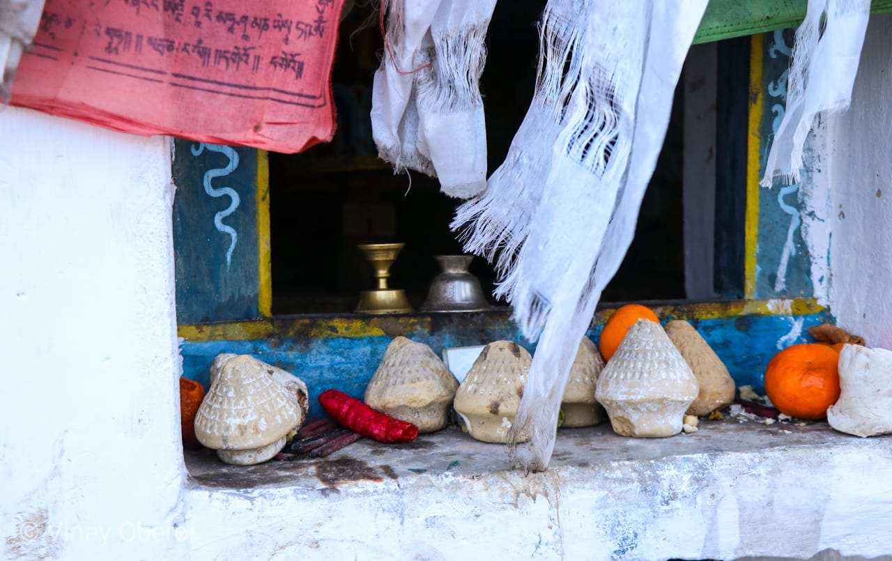 Little pagodas made from flour, some coloured, at a small shrine on the road to Dirang | Vinay Sheel Oberoi