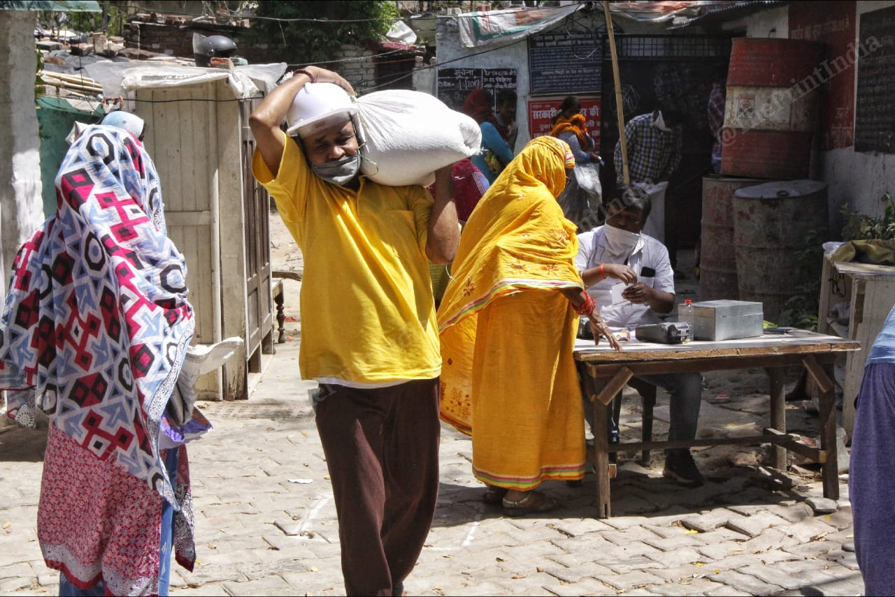 People outside the Dalibagh ration shop in Lucknow.   Photo: Praveen Jain/ThePrint
