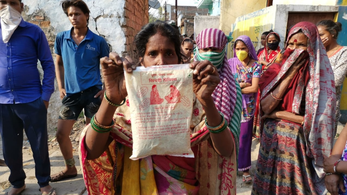 A resident shows a packet of sattu, which they've been forced to eat in the absence of rice and wheat
