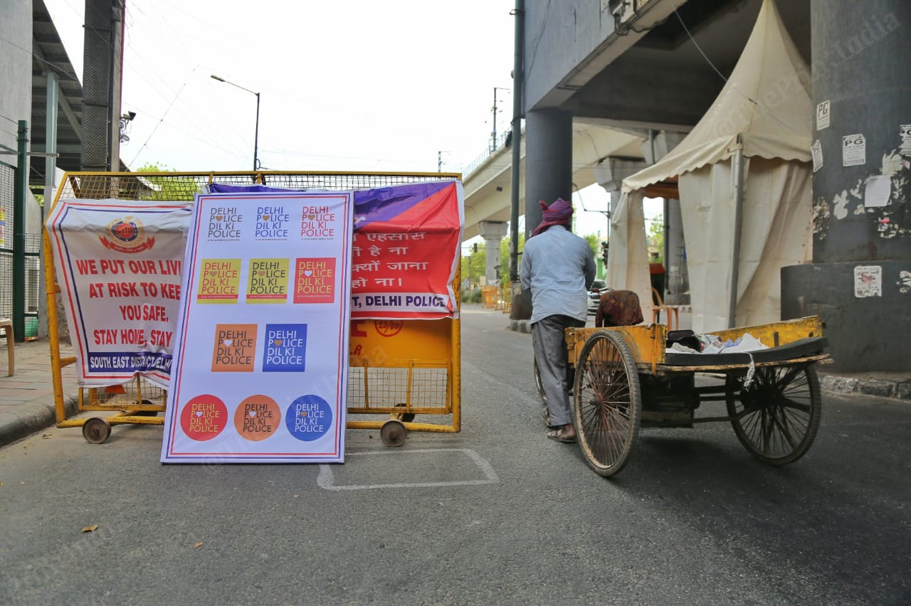 A Delhi Police banner, with its new Twitter handle name, at a barricade in Tughlaqabad Extension. Photo: Manisha Mondal | ThePrint