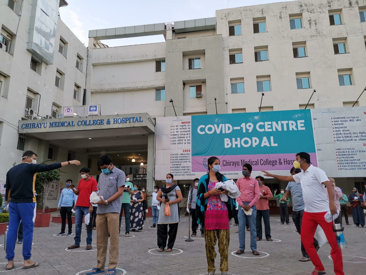 Patients stand outside the hospital, in line with social distancing norms | Angana Chakrabarti | ThePrint