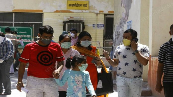 A family wearing masks outside Agra district hospital (representational image) | Photo: Praveen Jain | ThePrint