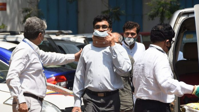 Anand Teltumbde arrives to surrender before the NIA on 14 April in Mumbai | Photo: PTI