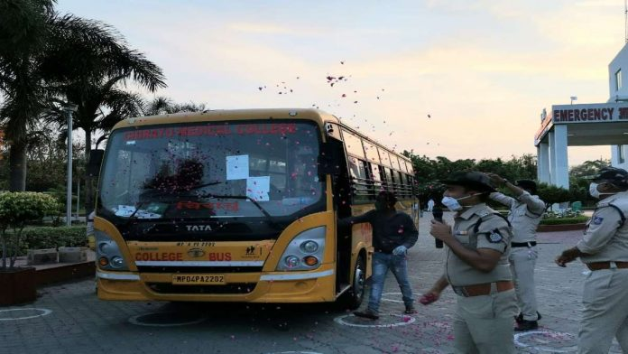 Rose petals are showered as the 44 patients discharged Wednesday evening set off from Bhopal's Chirayu Medical College and Hospital Wednesday evening | Angana Chakrabarti | ThePrint