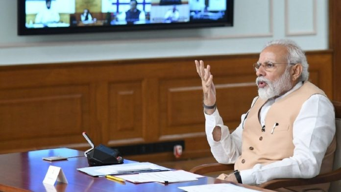 Prime Minister Narendra Modi holds a meeting via video conference amid the lockdown to prevent spread of Covid-19 | PIB | Twitter