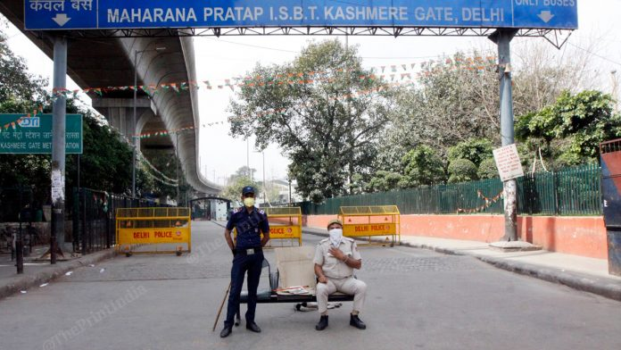 Police enforcing the nationwide lockdown in Delhi's Kashmere Gate | Photo: Praveen Jain | ThePrint