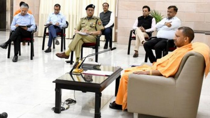 Uttar Pradesh Chief Minister Yogi Adityanath with police and administration officials at his residence Tuesday (representational image) | Photo: UP Information & Public Relations Department
