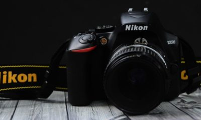 A photo of the Nikon D3500 DSLR on a dramatic black background.