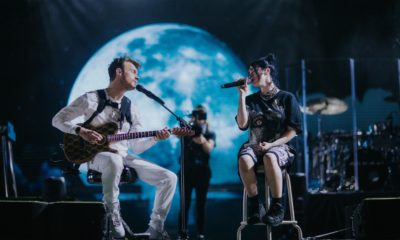 <p> Billie Eilish and brother Finneas perform together on stage</p>