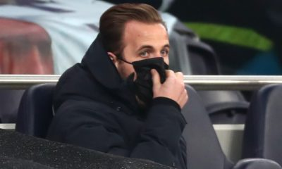 <p>The injured Harry Kane watches on during Tottenham's defeat against Chelsea</p>