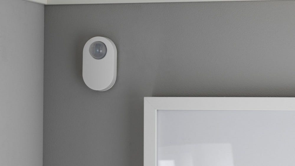 An IKEA Motion sensor in the corner of a room.