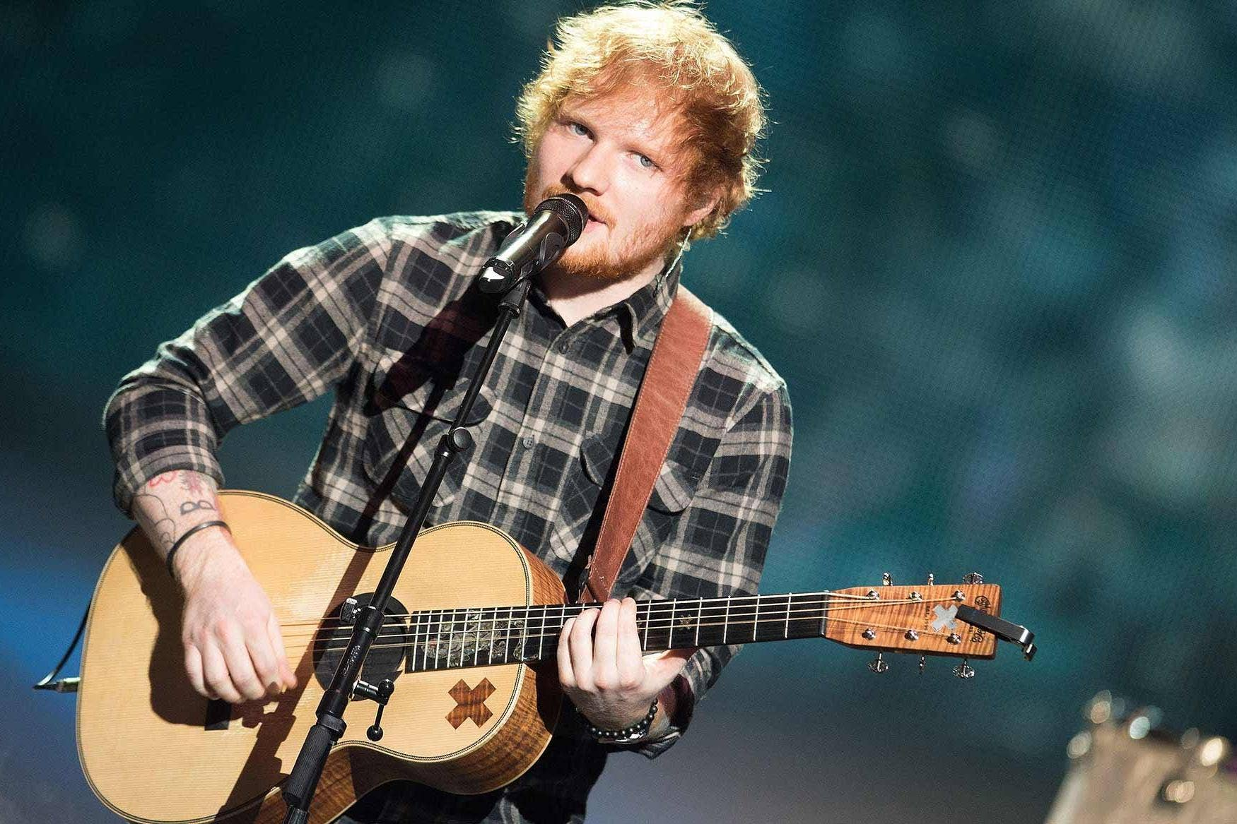 New father Ed Sheeran takes time away from nappies for guitar giveaway