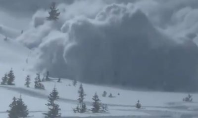 Incredible moment skier films himself being wiped out by avalanche