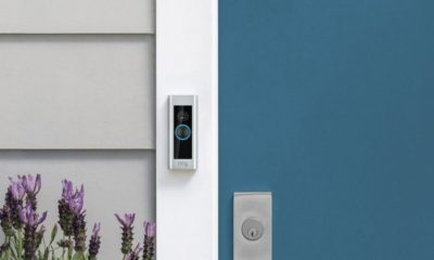 A Ring Video Doorbell Pro next to a blue door.