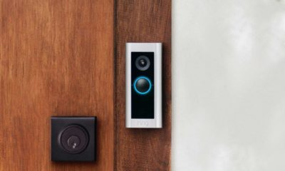 A Ring Video Doorbell Pro 2 on a wood door.