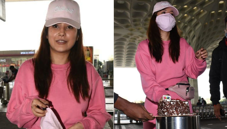 Shehnaaz Gill cuts a cake with the paps at the airport | Bollywood Bubble