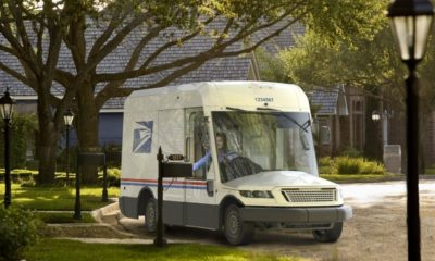 A next generation mail truck, with a huge windshield and small hood.