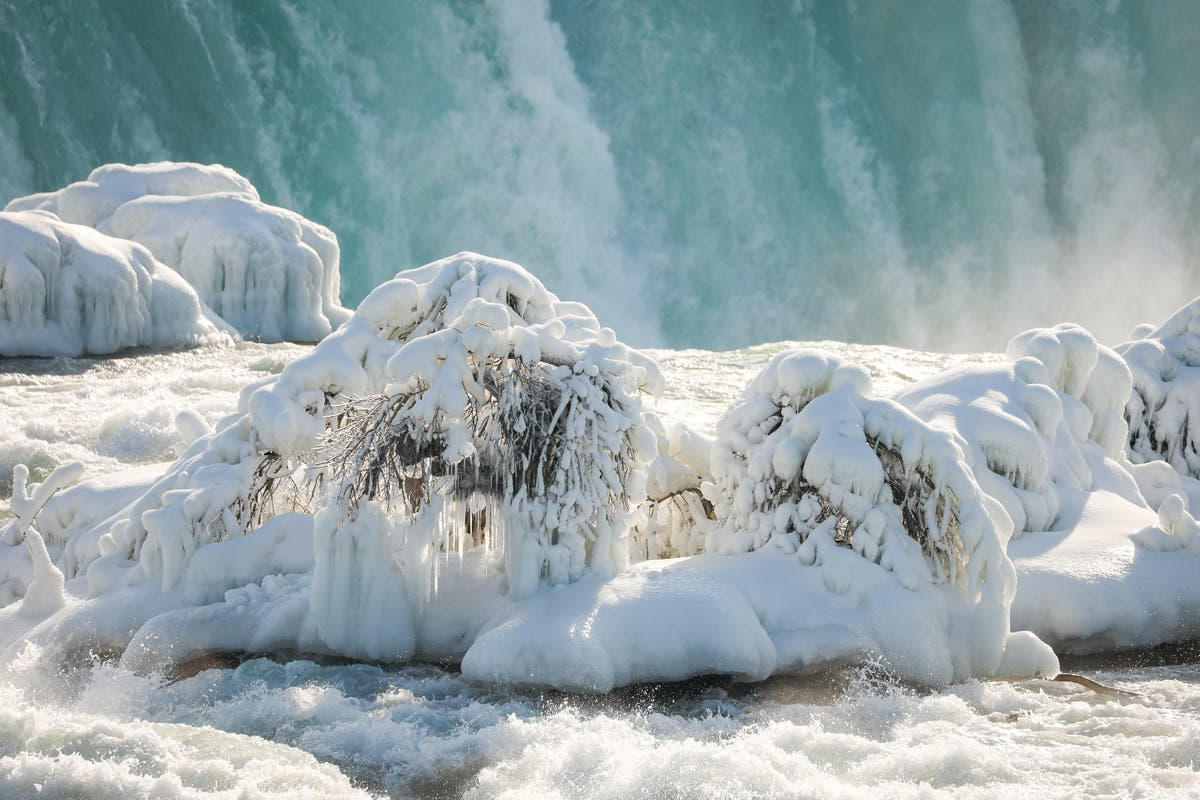US winter storm: Niagara Falls freezes over in brutal weather