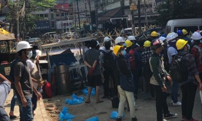 <p>Protesters made makeshift barricades to stop the military</p>