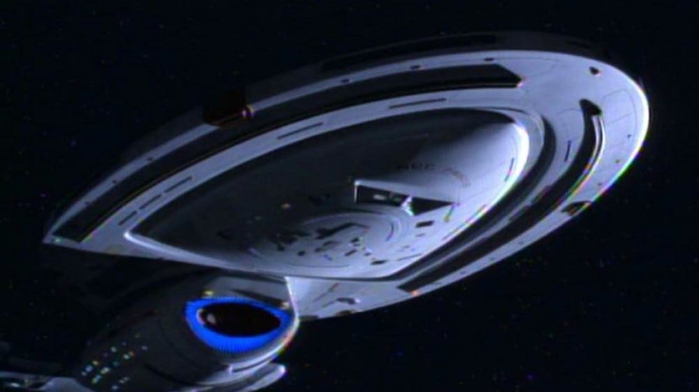The Starship Voyager, flying in space.
