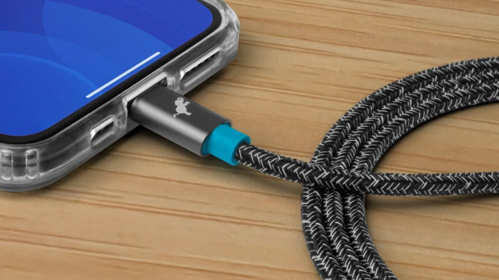 A PowerKnit cable connected to an iPhone