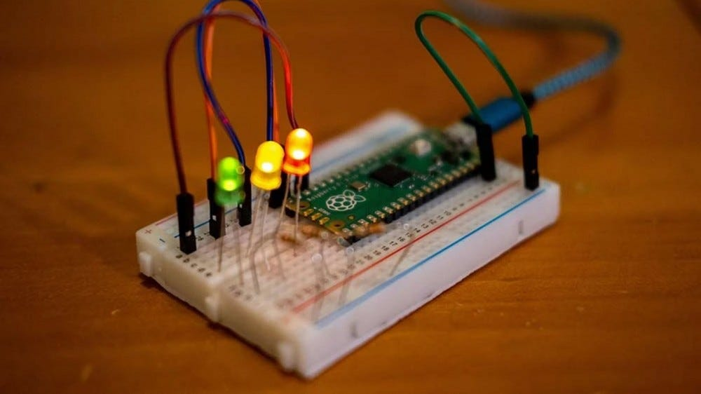 Some LEDs attached to a breadboard with a Pi Pico