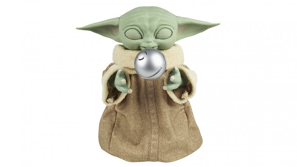 """A Grogu toy floating a shifter knob """"with the Force."""""""