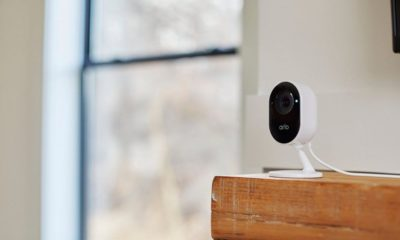 An Arlo Essential Indoor Camera with a recording light turned on.