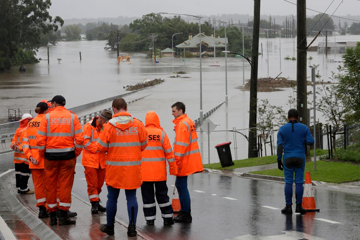 Australia floods: Dozens of towns isolated and 18,000 evacuated