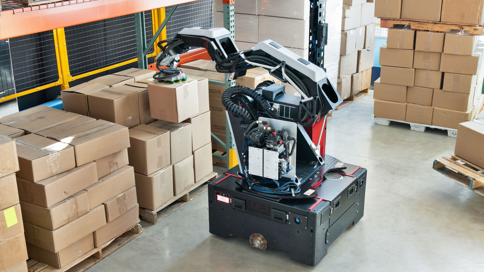 A photo of the Boston Dynamics Stretch robot in a warehouse.