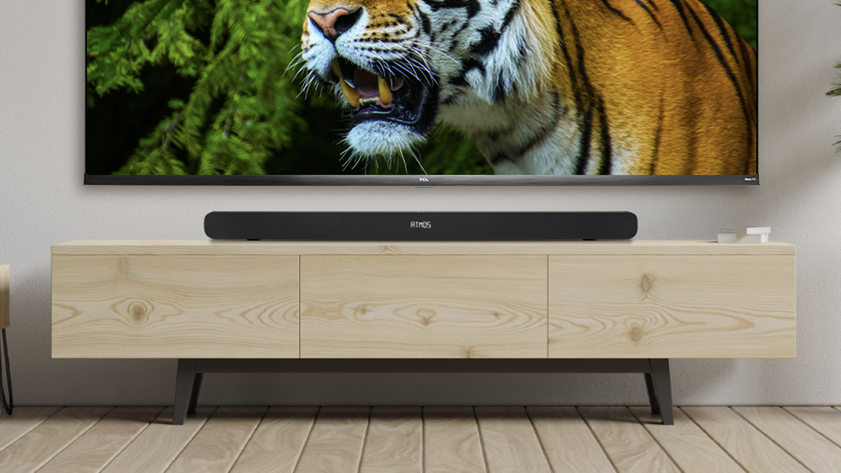 A photo of the TCL Alto 8i subwoofer in an entertainment center.