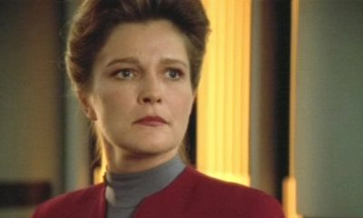 Captain Janeway, looking off into the distance.