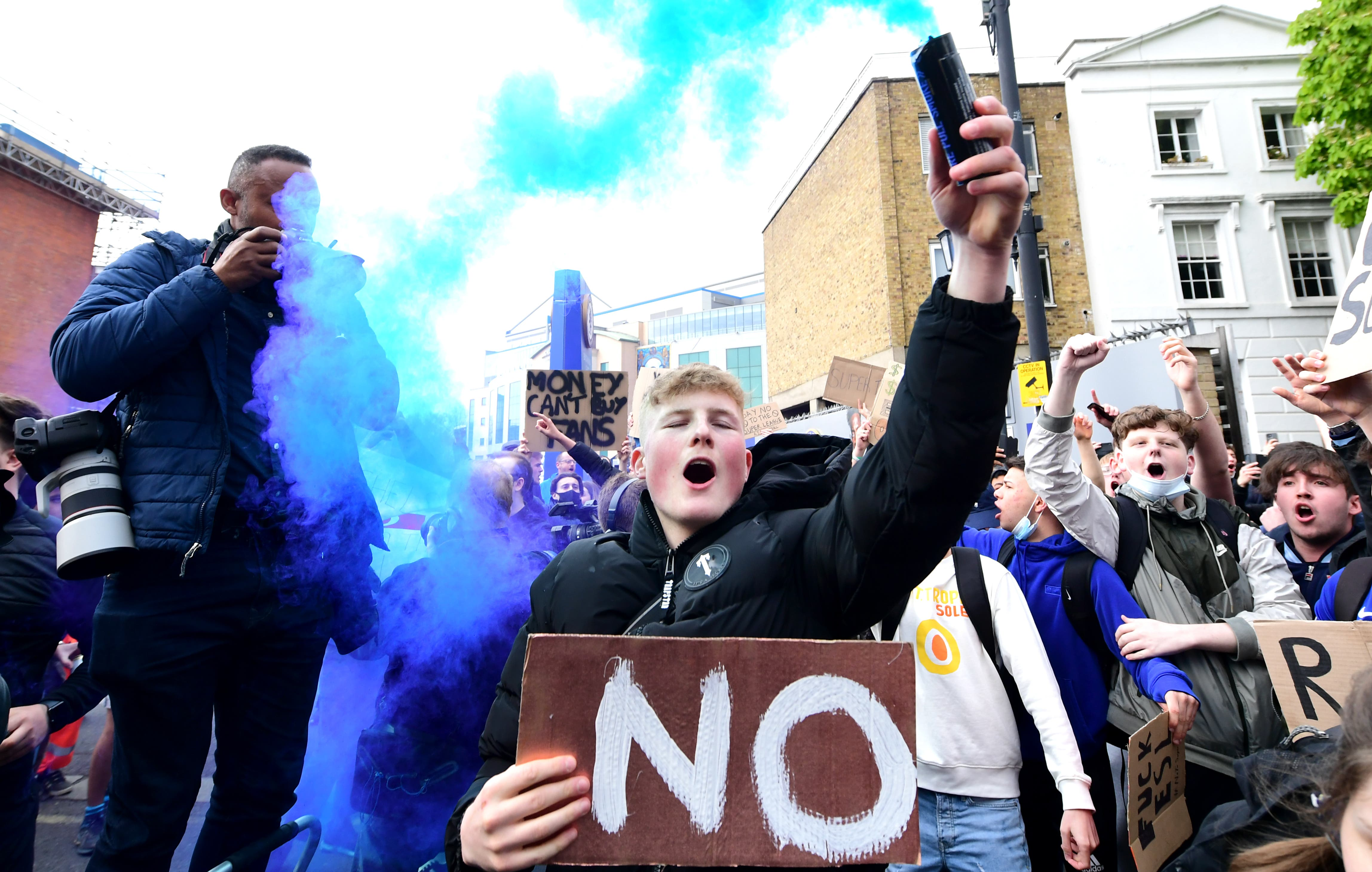 Chelsea fans outside Stamford Bridge protest against the club's involvement in the proposed European Super League