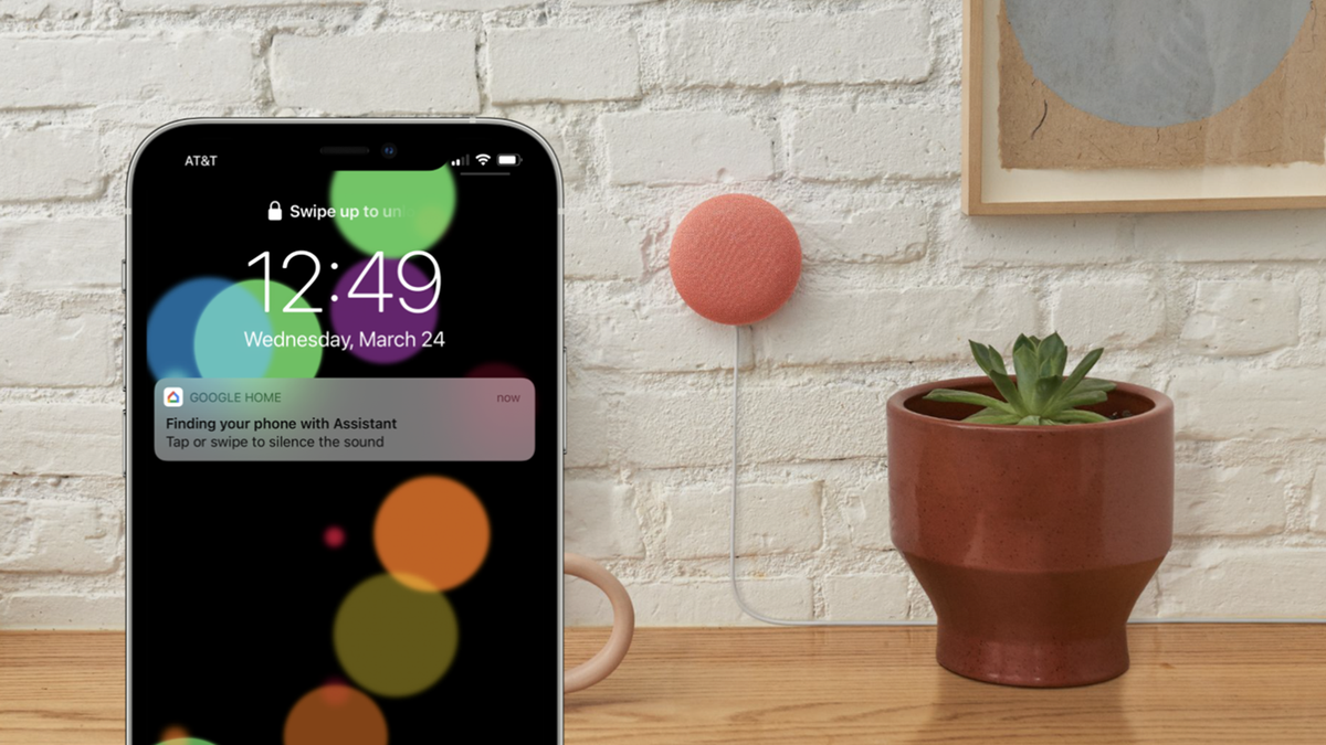 """An iPhone with a """"finding your phone with Assistant"""" message on it."""