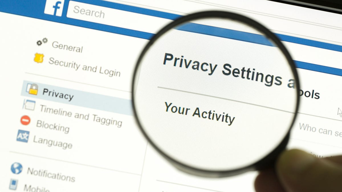 A Facebook privacy page with a magnifying glass over the word privacy.