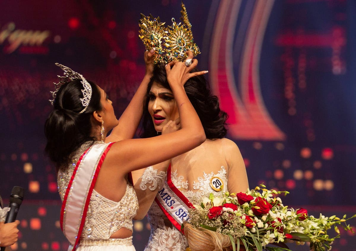 Mrs World arrested for ripping crown from winner for 'being divorced'