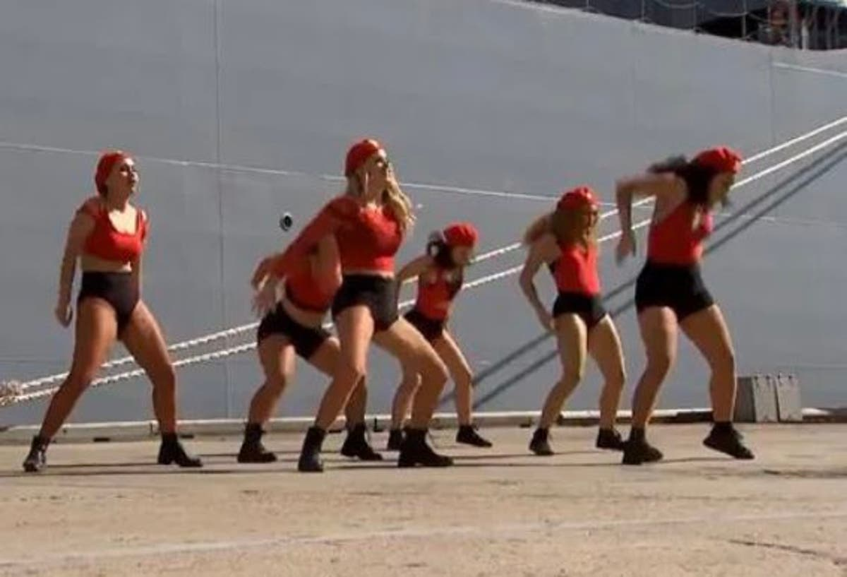 Twerking dancers trolled after 'creepy' edit at battleship unveiling