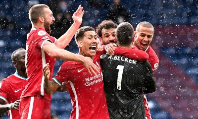 <p>Liverpool players mob goalkeeper Alisson after his goal against West Brom</p>