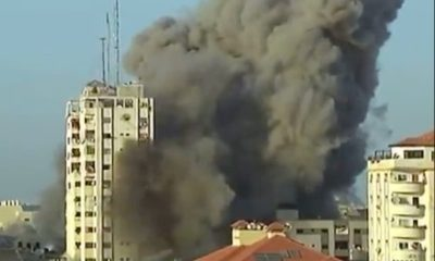 Watch: Gaza journalist ducks as nearby building is destroyed by missile