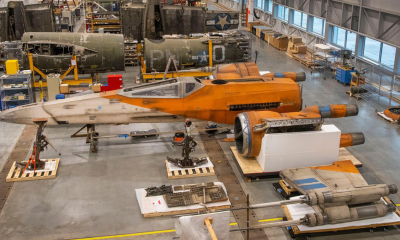 The T-70 X-Wing prop in a restoration hangar
