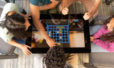 A digital board game table with 'Connect4' on the screen