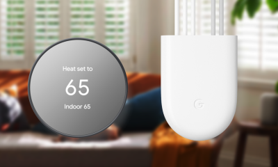 Google Nest Thermostat and companion Power Connector adapter in front of a living room setting