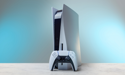 Sony PlayStation 5 and controller standing on a modern table
