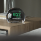 The NightWatch on a nightstand holding an Apple Watch
