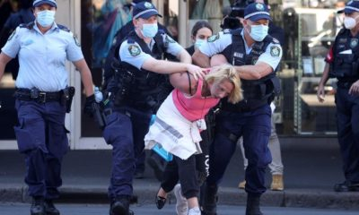 Australia sees record number of cases amid protests over lockdown restrictions - LIVE