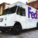 New Xos FedEx electric vehicle parked in front of business