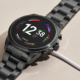 The Fossil Gen 6 smartwatch on its small charging puck.