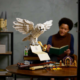 LEGO's new Hogwarts Icons set on table, with person sitting behind it reading